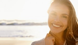smiling girl with beach and bright skin
